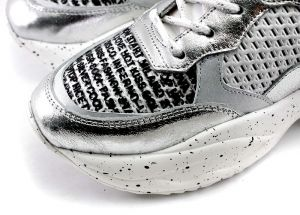 Women's sneakers made of perforated leather in light colors. The insole and the lining are made of genuine leather.